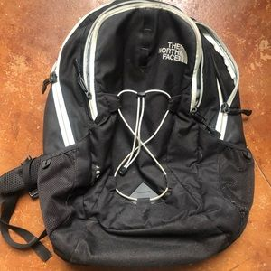 NorthFace black and mint jester backpack